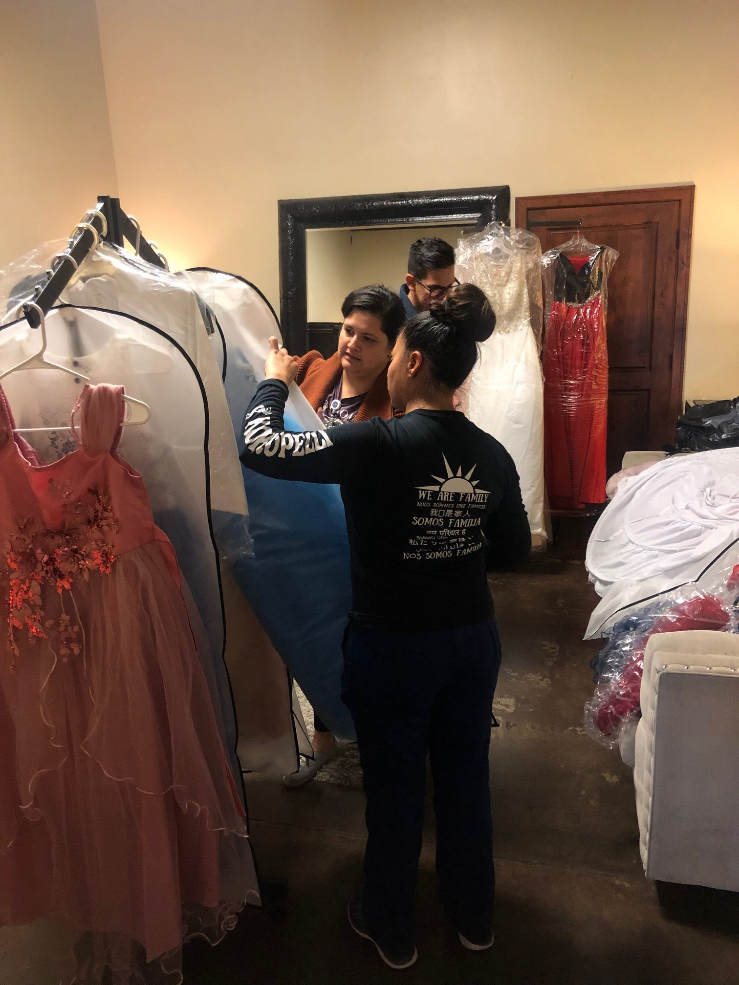Youth looking through quinceanera attire