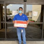 Image of man holding a box