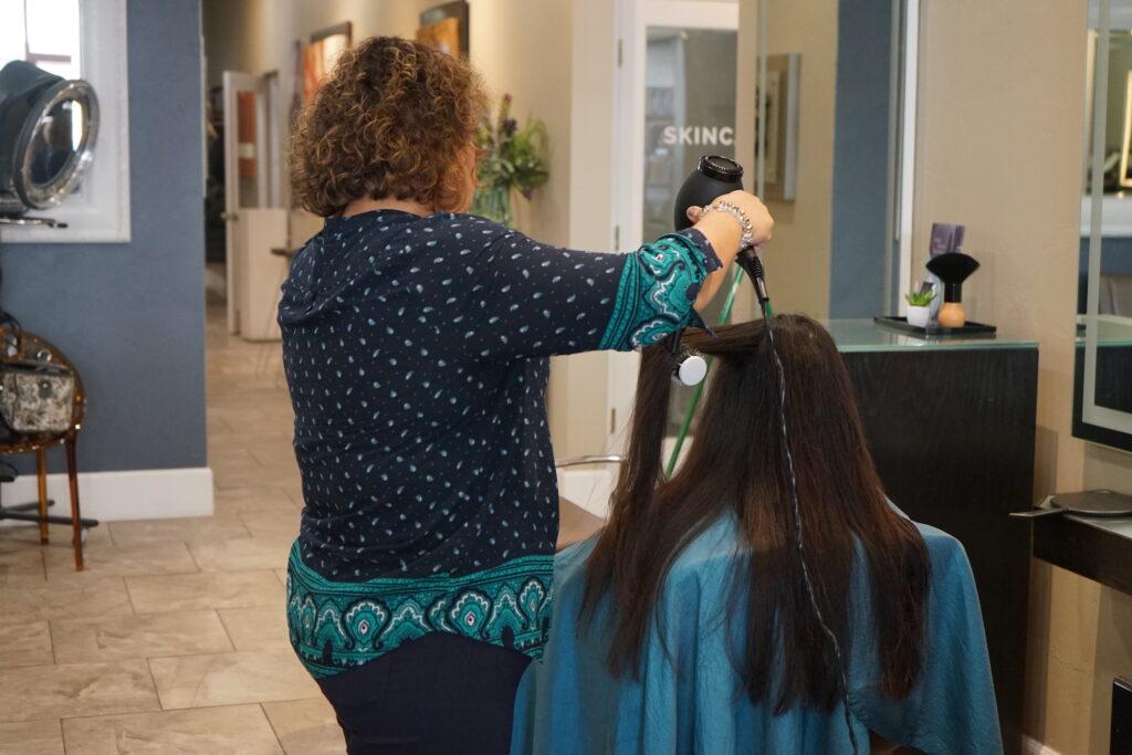 Girl getting hair blown out