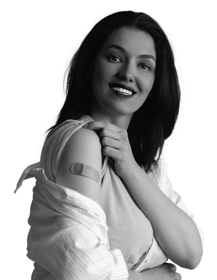 Woman showing off bandaid on upper arm